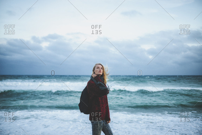 Young woman at the seashore in winter