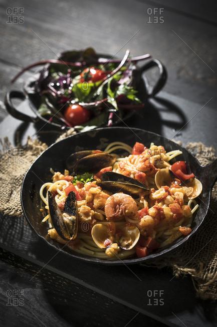Spaghetti Frutti di Mare with leaf spinach lettuce dish