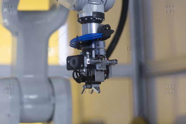 Robot arm in a sensor technology plant
