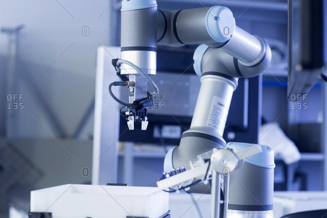 Robot arm in a sensor technology plant