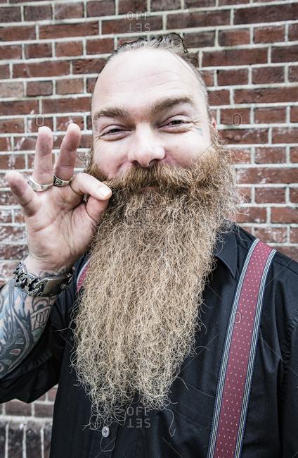 Happy bearded biker smiling