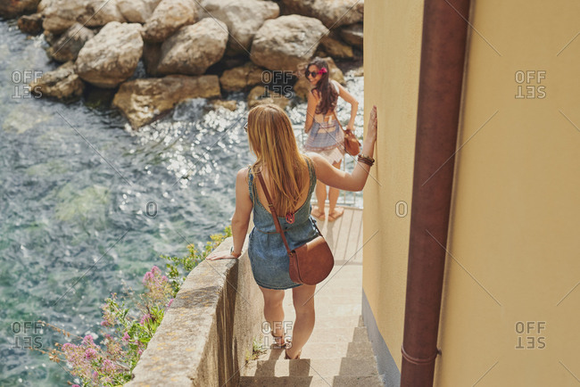 Women friends travelling in beautiful Italy relaxing summer vacation exploring to discover carefree lifestyle