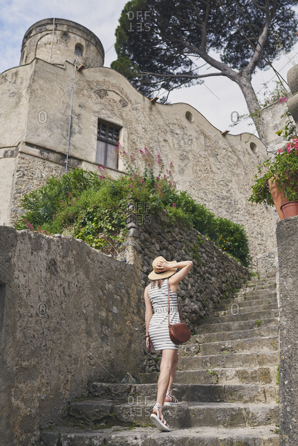 Woman travelling in beautiful Italy relaxing summer vacation exploring to discover coastal Amalfi