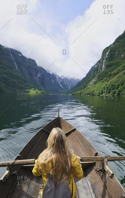 Adventure woman enjoying majestic river view from row boat epic landscape travel discover explore beautiful earth