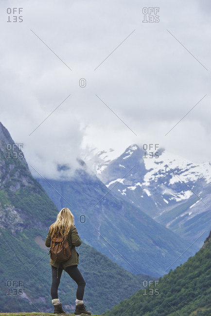 Travel adventure woman enjoying view of majestic glacial valley on exploration discover beautiful earth