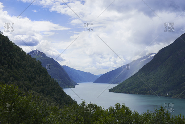 Majestic beautiful fjord landscape in Norway Fjord lake mountain snow water reflection glacial valley
