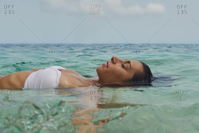 Beautiful woman swimming underwater on paradise beach freedom wellbeing lifestyle summer vacation wanderlust mindfulness