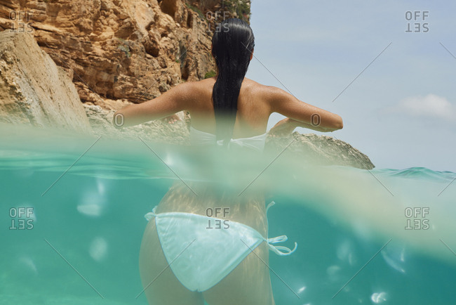 Beautiful woman swimming underwater on paradise beach freedom wellbeing lifestyle summer vacation wanderlust
