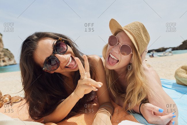 Carefree Travel happy friends pose for photograph peace sign paradise beach for destination lifestyle vacation