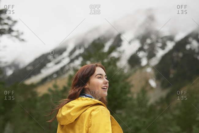 Adventure travel hiker woman exploring in beautiful green forest snow mountains on scenic outdoor tourist vacation
