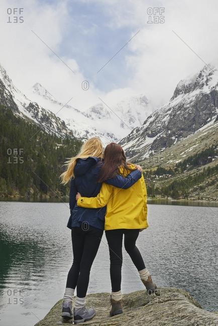 Adventure woman enjoying view of majestic mountain lake explore travel discover beautiful earth
