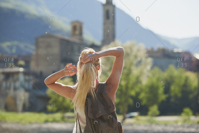 Travel woman looking at view of historical european town on adventure in Italy