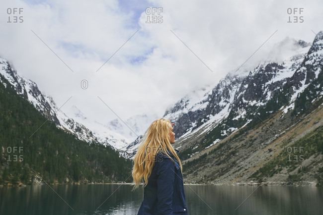 Travel adventure hiker woman on mountain lake enjoying beautiful nature landscape wanderlust