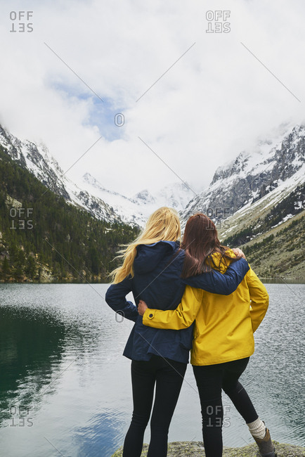 Adventure woman enjoying view of majestic mountain lake explore travel discover beautiful earth