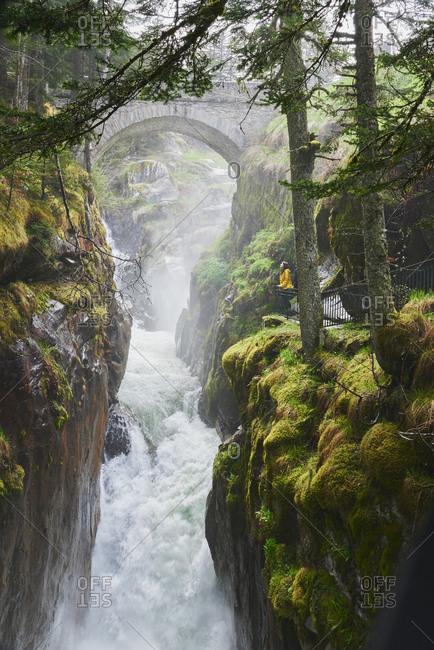 Adventure woman exploring Beautiful waterfall natural wonder on vacation