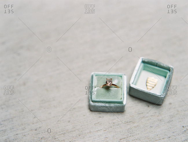 Engagement ring in a light blue jewelry box