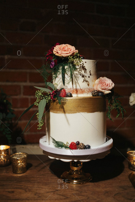 Two-tier wedding cake with floral decorations