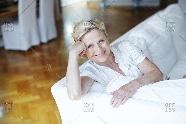 Portrait of smiling mature woman on Sofa