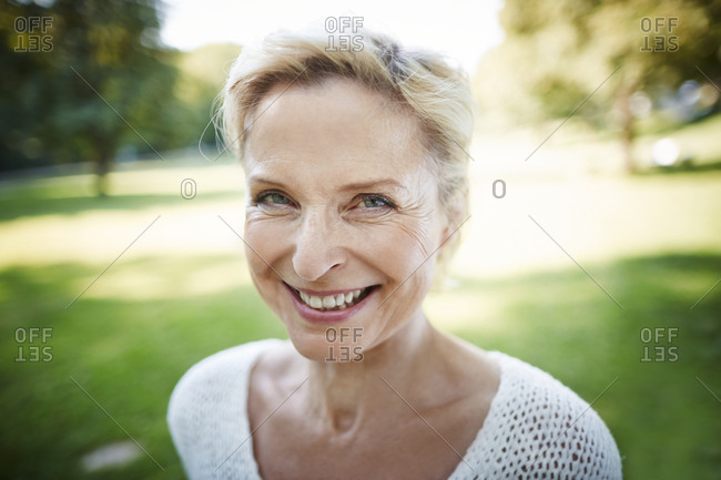 Portrait of smiling mature woman in a park