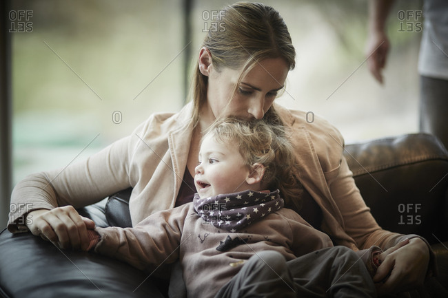 Mother and daughter resting on couch