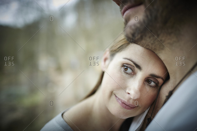 Woman leaning against man's shoulder