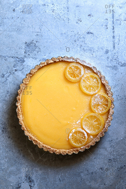 Classic lemon tart garnished with candied lemon slices.