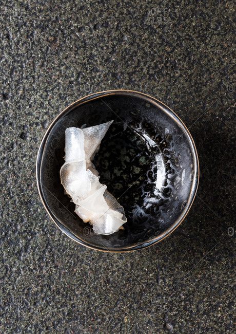 Seafood served in a black Japanese pottery bowl