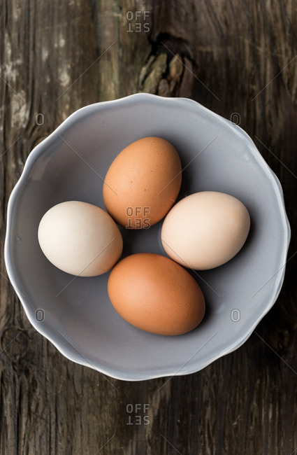 Overhead view of four eggs in a bowl