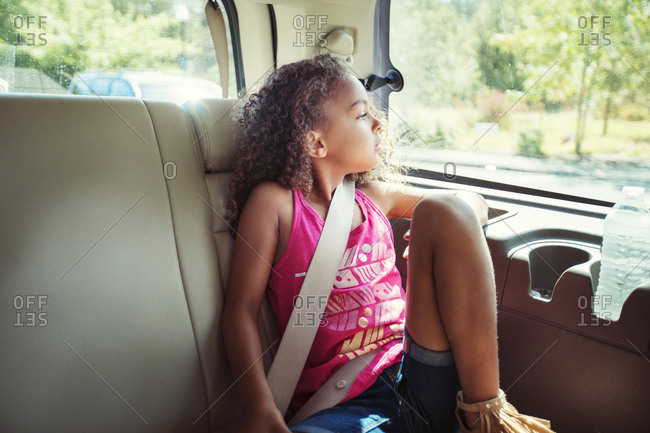 Girl looking away while traveling in car