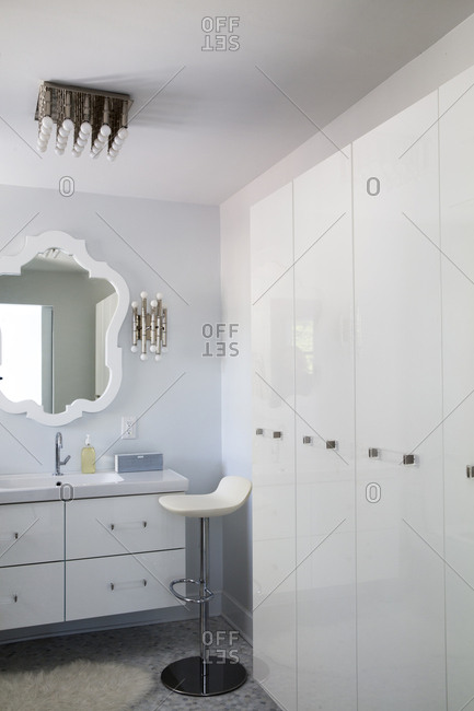 Chair by cabinet in bathroom