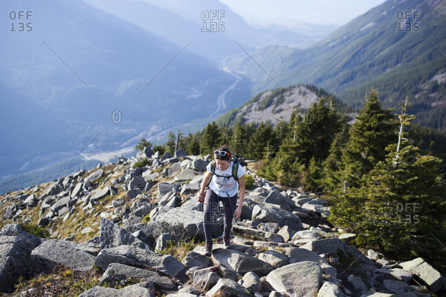 High angle view of woman walking on rocks at mountain