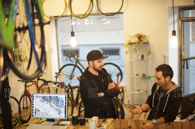 Friends talking at bicycle workshop