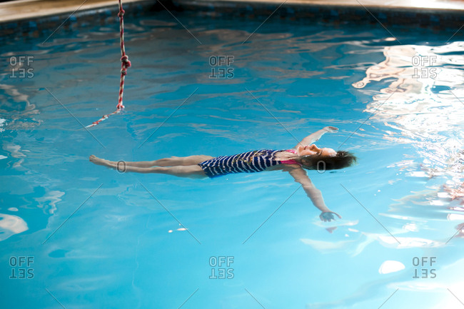High angle view of girl swimming in water