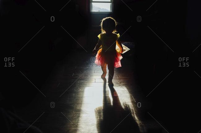 Full length of girl walking in dark room