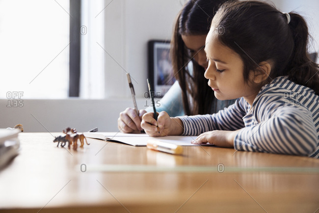 Girls studying while sitting at table