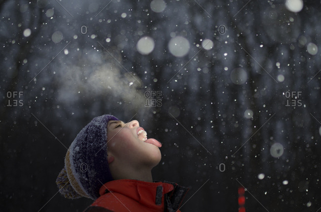 Boy with mouth open during snowing