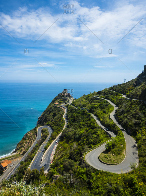 Italy- Sicily- Sant'Alessio Village- view to winding road from above