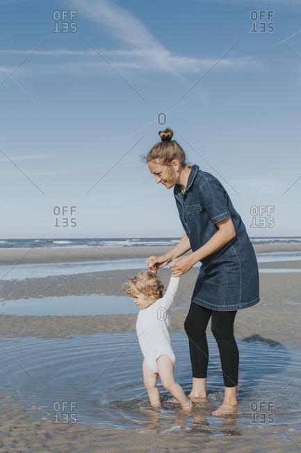 Netherlands- Schiermonnikoog- mother with little daughter on the beach
