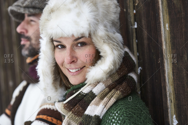 Portrait of smiling woman wearing fur cap in winter