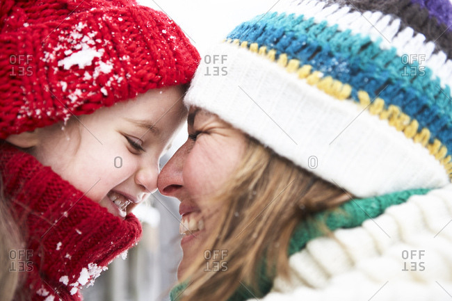 Mother and daughter having fun in winter