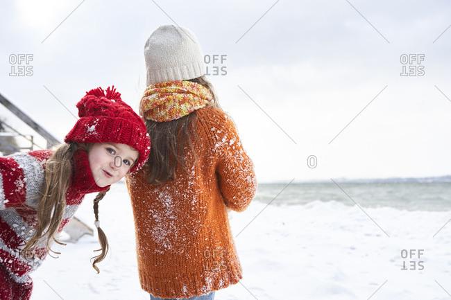 Sisters having fun in winter