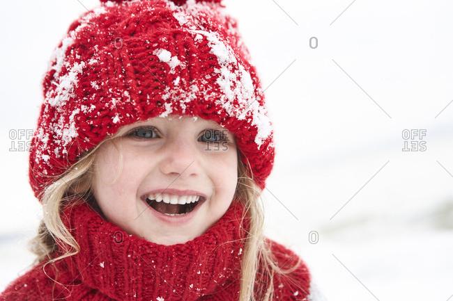 Little girl having fun in winter- portrait