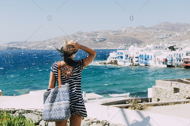 Greece- Mykonos- back view of tourist looking to Little Venice