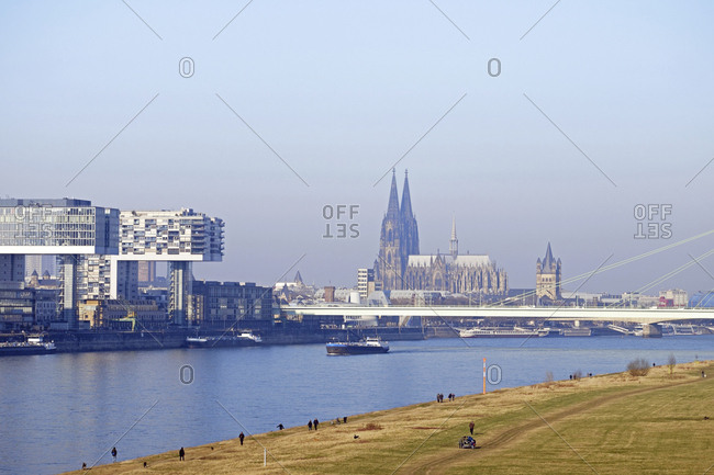Germany- Cologne- Crane Houses at River Rhine and Cologne Cathedral in the background