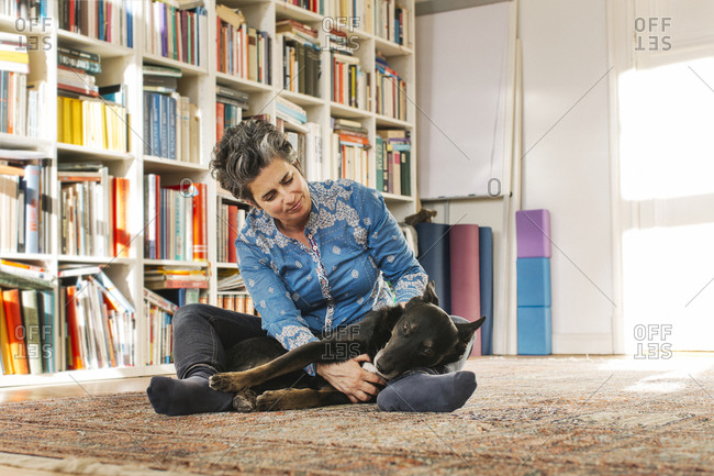 Woman with her dog on the floor at home
