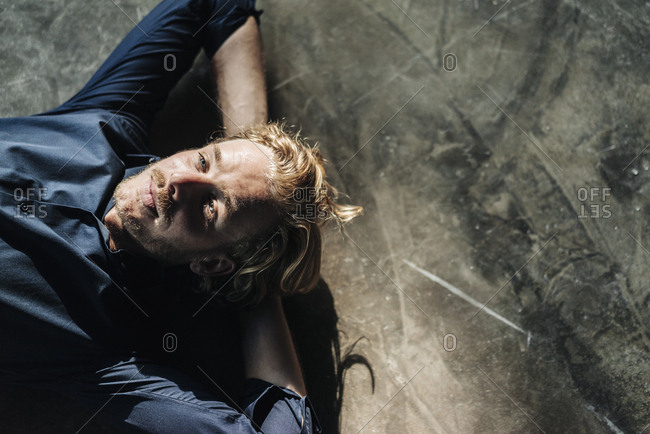 Man lying on floor looking up