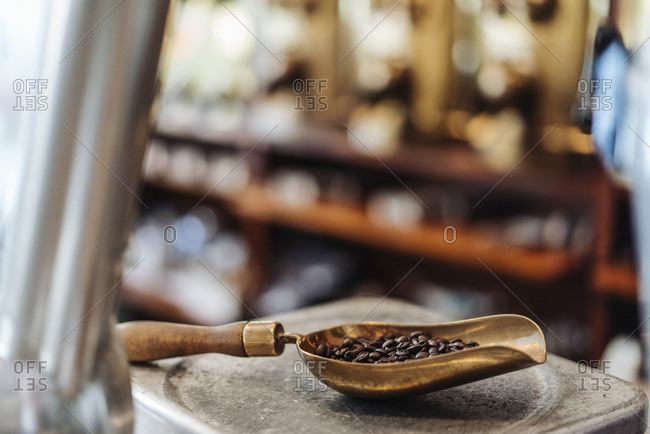 Shovel with coffee beans in a coffee roastery
