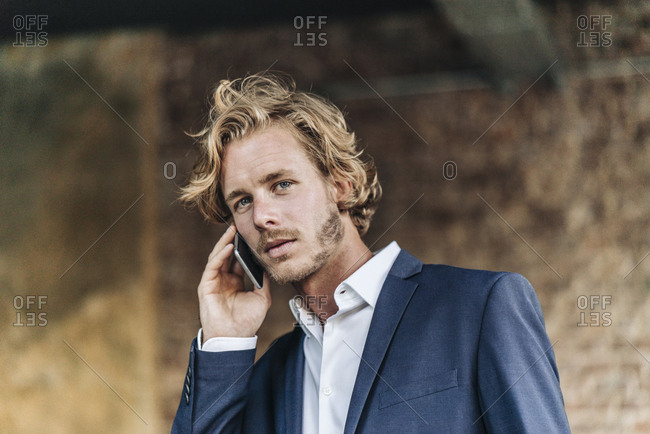 Confident businessman on cell phone