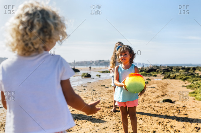 Children playing with ball on the beach
