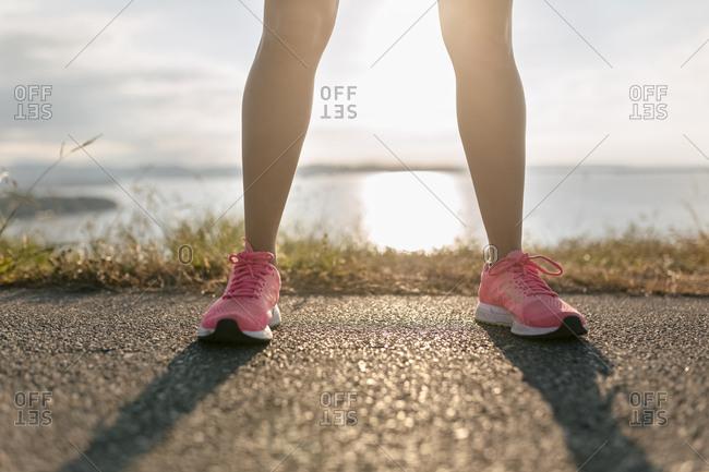 Legs of a running woman